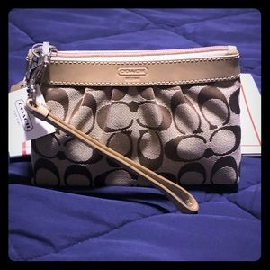 Coach putty colored wristlet
